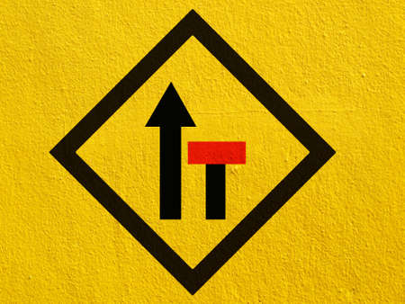 stucco wall: warning road signs painted on a stucco wall outside Stock Photo