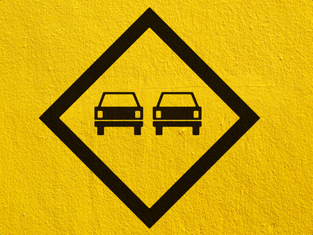 steep cliffs sign: road signs painted on a stucco wall outside