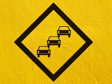 steep cliff sign: road signs painted on a stucco wall outside