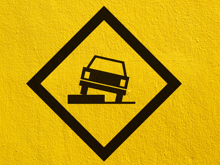stucco wall: warning Road Sign painted on a stucco wall outside Stock Photo