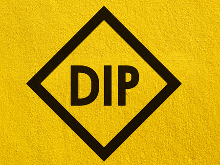 stucco wall: DIP Sign painted on a stucco wall outside Stock Photo