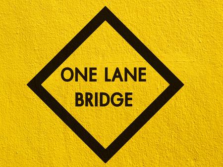 stucco wall: One Lane Bridge painted on a stucco wall outside