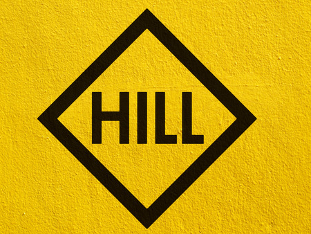 Hill Sign painted on a stucco wall outside photo