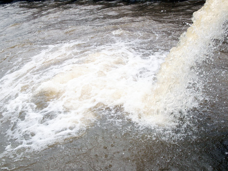 gunk: Photo of flow out water from the conduit of Industrial factory to the river  Stock Photo
