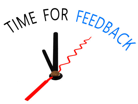 Time for feedback with clock concept photo