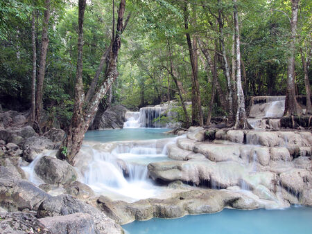 Waterfall with water flowing around  photo