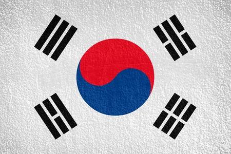 South Korea, korean flag on wall textured background photo