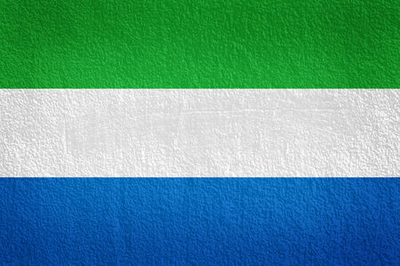 sierra leone: Sierra leone Flag on the old wall texture Stock Photo