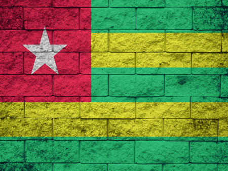 clime: togo Flag on the old wall texture