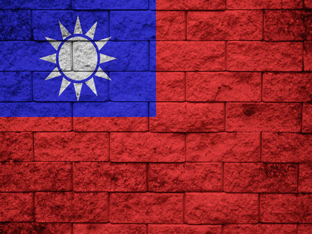 disintegrate: Taiwan Flag painted on grunge wall