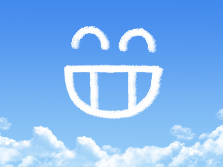 smilie: Smilie from cloud in the blue sky Stock Photo