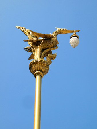 Thai traditional beautiful golden swan on street lamp post in Bangkok, Thailand. photo