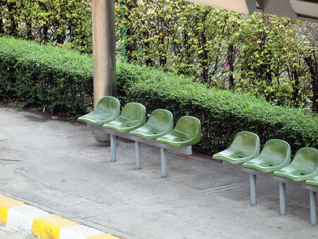 bus station: Bus station with green plastic seats in the park
