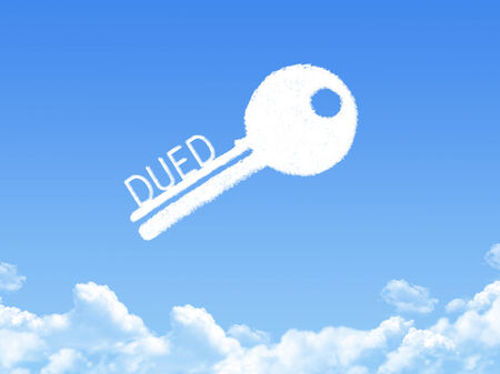 financial condition: Key to Dued cloud shape Stock Photo