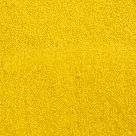 light in dark: yellow wall background Stock Photo