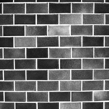 brick and mortar: black blocks wall background