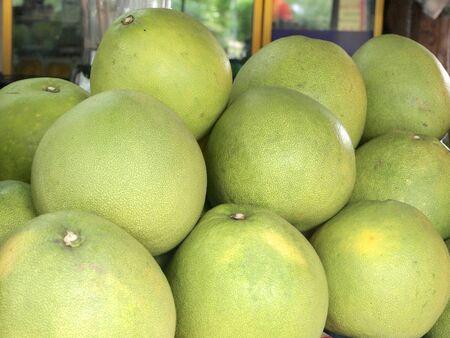 pomelo: Fresh pomelo sold in markets
