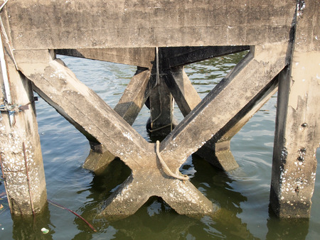 reinforced: close-up of reinforced concrete bridge across the river