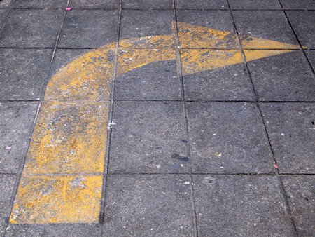 markings: Arrow signs as road markings on a street