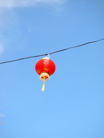 Red Chinese Paper Lanterns against a Blue Sky photo