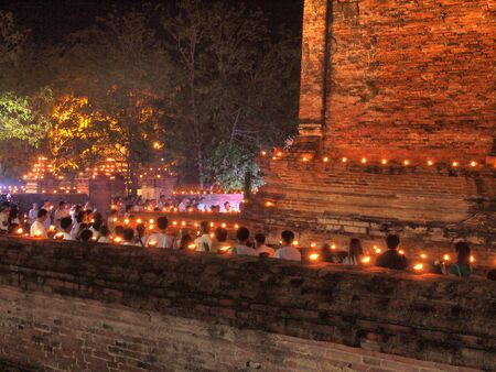 Ayutthaya, Thailand - May 13, 2014:  Visakha Bucha Day.These votary agreed together in the rituals, prayers and meditate on Buddhist holy days at Wat Mahaeyong temple.