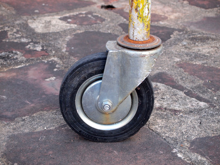 consignment: Closeup of loose wheel of industrial cart