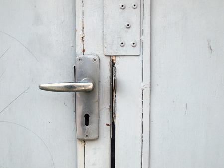 door knob: Aluminium door knob on the white door Stock Photo