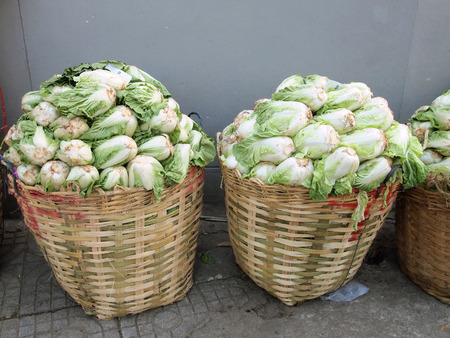 kept: Fresh green cabbages kept in basket for retail purpose at the market.