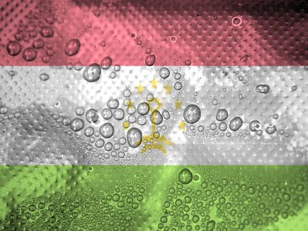 clime: water drops on Tajikistan flag background Stock Photo