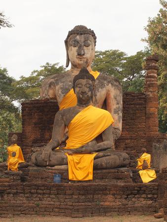 december 25: Sukhothai,Thailand - December 25, 2014: Old Buddha statue in Wat Phra Prang