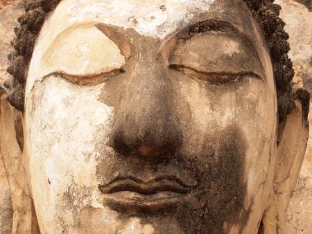 religious clothing: Sukhothai,Thailand - December 25, 2014: Old Buddha statue in Wat Phra Prang