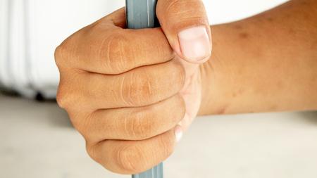behind bars: hands behind bars