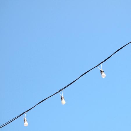 lamp on blue sky Background Stock Photo
