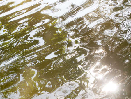 reflection in water: Water with reflection pattern background Stock Photo