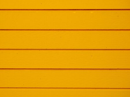 yellow wood panels used as background