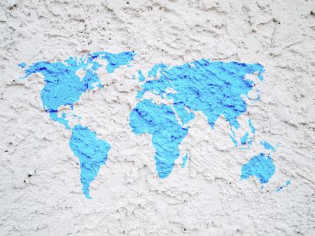 world map on white cement wall Standard-Bild