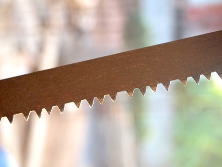 tenon: Close up a part of saw blade teeth