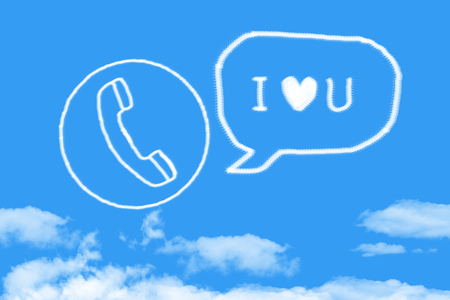 Voice love you from phone cloud shape on blue sky Stok Fotoğraf