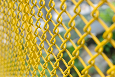 yellow wire fence close up