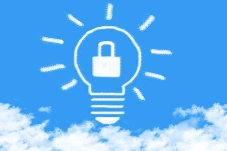 Light bulb with master key cloud shaped on blue sky Stock Photo