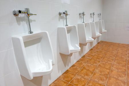 row of outdoor urinals men public toilet Stock Photo