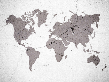 brown color world map on crack concrete wall background