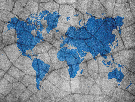 blue color world map on crack concrete wall background