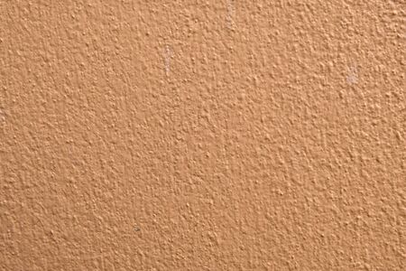 Brown cement wall background close up