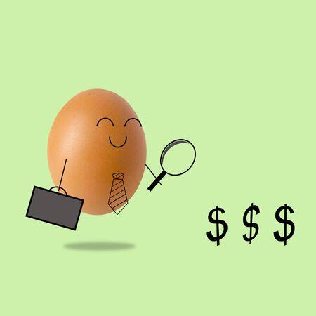 Businessman egg looking on dollar through magnifying glass 版權商用圖片