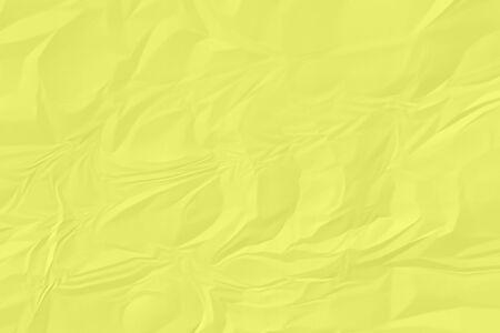 crumpled yellow paper background close up Banco de Imagens