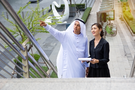southern european descent: Arabic businessman with his assistance looking for growth opportunities Stock Photo