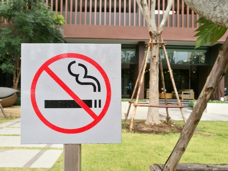 Non-smong sign put in the open area in front of the garden showing the area is prohibited for smoking
