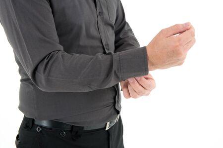 Hand organizing sleeve of dark brown shirt isolated on white background Imagens