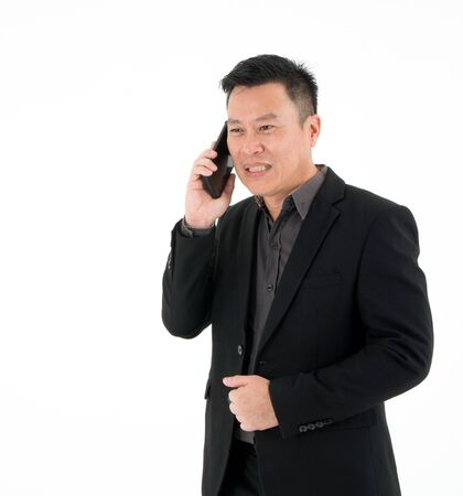 Portrait of businessman concentrates seriously talking on mobile phone discuss things isolated on white background
